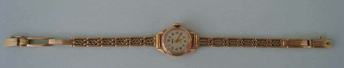 наручные часы золотым браслетом